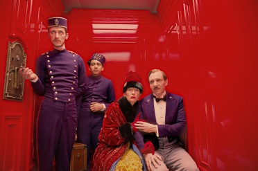 Purple pros: Ralph Fiennes comforts Tilda Swinton in the lift of the Grand Budapest Hotel